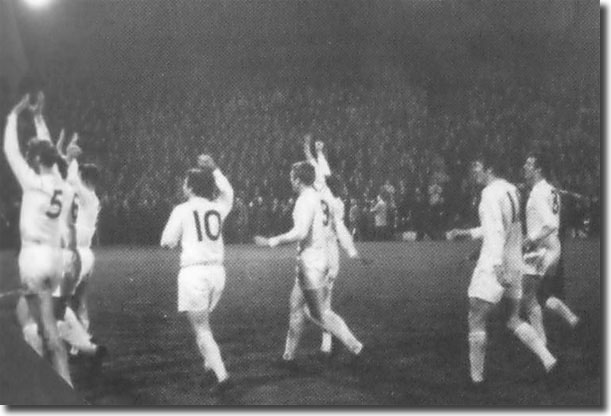 Leeds United's Champions take the tributes of the Liverpool Kop