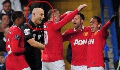 Former Man U favourite Howard Webb celebrates with his team-mates... but at least he wasn't from Manchester