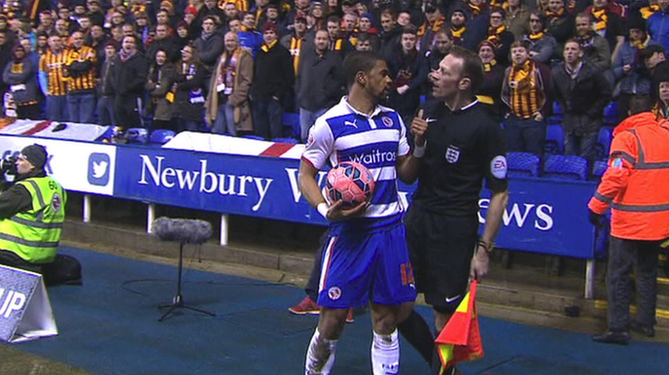 Garath McCleary complains to a match official about abuse from the Bradford support